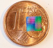 Optical chip carrying a multitude of silicon nitride microresonators (Picture: J. N. Kemal/ P. Marin Palomo/KIT)